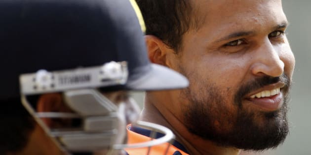 India's Yusuf Pathan smiles during a training session in the nets in Dhaka, Bangladesh, Sunday, March 11, 2012. India will play Sri Lanka in their first match of the Asia Cup Tuesday. (AP Photo/Pavel Rehman)