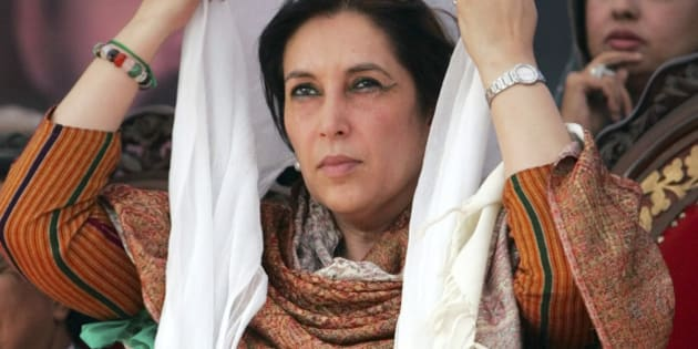 Former Pakistani Prime Minister Benazir Bhutto adjusts her scarf at a campaign rally in Pabbi, 120 kilometers (75 miles) west of Islamabad, Pakistan, Wednesday Dec. 12, 2007. Bhutto repeated accusations that Musharraf will try to cheat by using police, judiciary officials and administration functionaries. (AP Photo/Greg Baker)