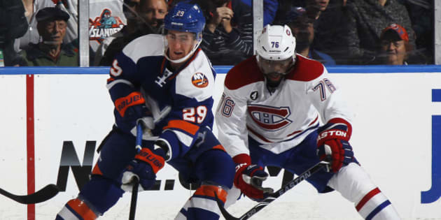UNIONDALE, NY - DECEMBER 23:  P.K. Subban #76 of the Montreal Canadiens and Brock Nelson #29 of the New York Islanders vie for the puck in the first period at Nassau Veterans Memorial Coliseum on December 23, 2014 in Uniondale, New York.  (Photo by Bruce Bennett/Getty Images)