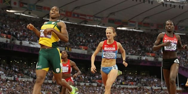 South Africa's silver medalist Caster Semenya (L) competes in the women's 800m final at the athletics event of the London 2012 Olympic Games on August 11, 2012 in London. AFP PHOTO / FRANCK FIFE        (Photo credit should read ADRIAN DENNIS/AFP/GettyImages)