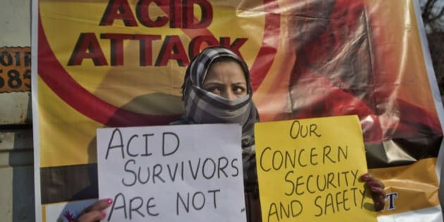 Fareen, a Kashmiri law student holds placards as she participates in protest against an acid attack on a woman in Srinagar, Indian controlled Kashmir, Friday, Dec. 12, 2014. A young woman law student was attacked with acid Thursday that left her in a critical condition, police said. (AP Photo/Dar Yasin)