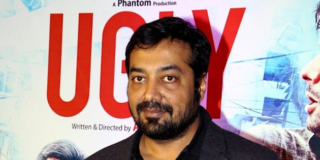 Indian Bollywood film director, screenwriter and producer Anurag Kashyap poses at the premier of Hindi Film 'Ugly' written and directed by Anurag Kashyap, in Mumbai on December 23, 2014.   AFP PHOTO        (Photo credit should read STR/AFP/Getty Images)