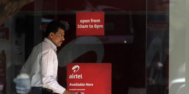 A man comes out from an Airtel center in Mumbai, India, Wednesday, Feb. 8, 2012. India's top mobile operator Bharti Airtel is reporting a 22 percent drop in quarterly profit due to higher interest rates and 3G network rollout costs, its eighth straight quarter of decline in net profit. (AP Photo/Rajanish Kakade)