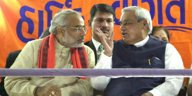 Indian Prime Minister Atal Bihari Vajpayee, right,  shares a joke with Gujarat's chief Minister Narendra Modi during a public meeting in Vadodara, 125 km (75 miles) south of Ahmadabad, India, Saturday, Dec. 7, 2002. Vajpayee is in Gujarat to campaign forthe rulling Bhartiya Janta Party for elections next week. (AP/ Siddharth Darshan Kumar)