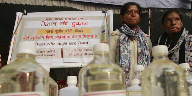 NEW DELHI, INDIA - DECEMBER 21: Acid attack victims sit on hunger strike demanding fast-track court for violence against women and effective and stringent laws against acid attacks at Jantar Mantar on December 21, 2014 in New Delhi, India. Acid attack victims ended their week long strike. (Photo by Sanjeev Verma/Hindustan Times via Getty Images)