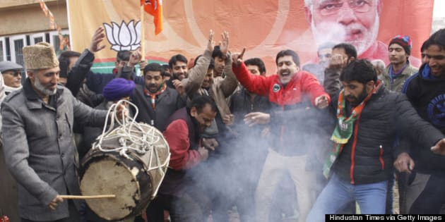 SRINAGAR, INDIA - DECEMBER 24: Bharatiya Janata Party supporters dance to celebrate their victory in the Jammu and Kashmir Assembly elections at party Headquarters on December 24, 2014 in Srinagar, India. Rightwing Hindu nationalist party led by Narendra Modi performed very well in only Muslim majority state of India as is emerged second largest party after PDP winning 25 out of total 87 seats. (Photo by Waseem Andrabi/Hindustan Times via Getty Images)
