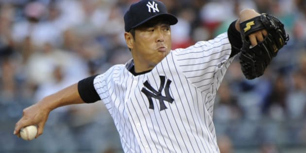 New York Yankees pitcher Hiroki Kuroda delivers the ball to the Toronto Blue Jays during the first inning of a baseball game Friday, July 25, 2014, at Yankee Stadium in New York. (AP Photo/Bill Kostroun)