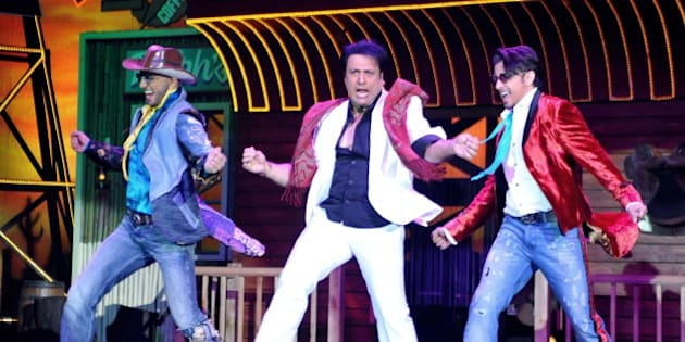 Indian Bollywood film actors Ranveer Singh, (L), Govinda (C) and Ali Zafar perform during the promotion of the upcoming Hindi film 'Kill/Dil' directed by Shaad Ali in Mumbai on October 31, 2014.   AFP PHOTO        (Photo credit should read STR/AFP/Getty Images)
