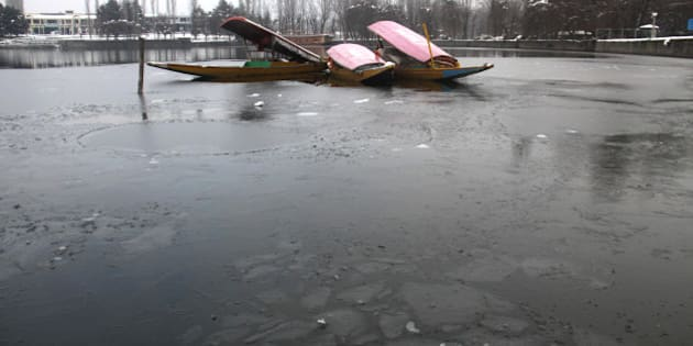 SRINAGAR, INDIA - JANUARY 2: The picture shows a frozen part of a Dal Lake on January 2, 2014 in Srinagar, India. A cold wave further tightened its grip in Jammu and Kashmir with most places recording sub-zero temperatures. (Photo by Waseem Andrabi/Hindustan Times via Getty Images)