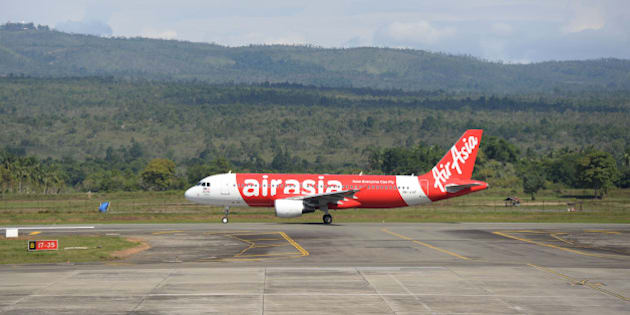 An AirAsia Bhd aircraft taxis on the runway at Sultan Iskandar Muda International Airport in Banda Aceh, Indonesia, on Thursday, Dec. 11, 2014. The tsunami unleashed a decade ago by a 9.1-magnitude undersea earthquake off the Sumatran coast was the deadliest natural disaster this century, taking more than 220,000 lives and leaving more than 1.5 million homeless. While families will never be rebuilt nor the trauma forgotten, interviews with survivors across the devastated coastlines of Thailand, India, Sri Lanka and Indonesia show how lives have been transformed. Photographer: Dimas Ardian/Bloomberg via Getty Images