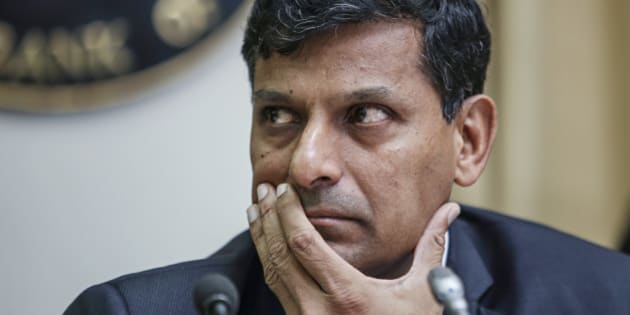 Raghuram Rajan, governor of the Reserve Bank of India (RBI), attends a news conference at the central bank's headquarters in Mumbai, India, on Tuesday, Dec. 2, 2014. Rajan left interest rates unchanged for a fifth straight meeting while signaling a possible easing early next year after Prime Minister Narendra Modis government called for lower borrowing costs. Photographer: Dhiraj Singh/Bloomberg via Getty Images