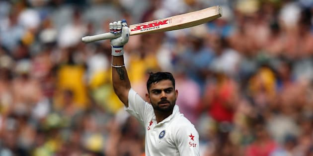 MELBOURNE, AUSTRALIA - DECEMBER 28:  Virat Kohli of India raises his bat after scoring 100 runs during day three of the Third Test match between Australia and India at Melbourne Cricket Ground on December 28, 2014 in Melbourne, Australia.  (Photo by Darrian Traynor/Getty Images)