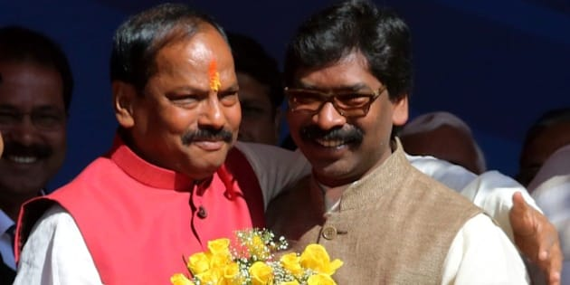 Newly elected Chief Minister of the eastern Indian state of Jharkhand Raghubar Das (L) is congratulated by former Chief Minister Hemant Soren after swearing an oath of office at a ceremony in Ranchi on December 28, 2014.  Das of the Bharatiya Janata Party (BJP) was elected Chief Minister after the BJP won a convincing victory in recent state assembly elections which concluded on December 20.   AFP PHOTO/STR        (Photo credit should read STRDEL/AFP/Getty Images)