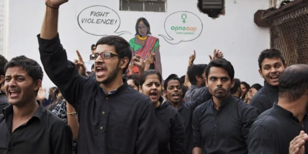Students perform a street play to create awareness on violence against women during a protest ahead of the second anniversary of the deadly gang rape of a 23-year-old physiotherapy student on a bus, in New Delhi, India, Monday, Dec. 15, 2014. The case sparked public outrage and helped make women's safety a common topic of conversation in a country where rape is often viewed as a woman's personal shame to bear. (AP Photo/Tsering Topgyal)