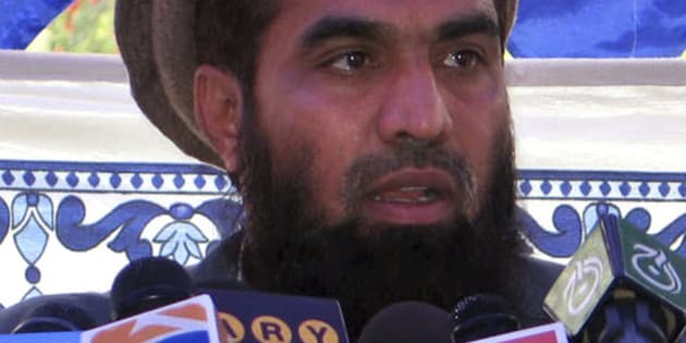 ** FILE ** In this file photo dated June 28, 2008, Pakistani Zaki-ur-Rehman Lakhvi speaks during a rally at Muzaffarabad, in Pakistani controlled Kashmir, Pakistan, Saturday, June 28, 2008. Security forces overran a militant camp on the outskirts of Pakistani Kashmir's main city and seized an alleged mastermind of the attacks that shook India's financial capital last month, officials said Monday. Backed by a helicopter, the troops grabbed Zaki-ur-Rehman Lakhvi among at least 12 people taken Sunday in the raid on the riverbank camp run by the banned group Laskhar-e-Taiba in Pakistani Kashmir, the officials said.  (AP Photo/Roshan Mughal)