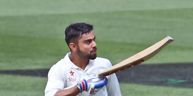 Indian batsman Virat Kohli celebrates after scoring a century (100 runs) against Australia during the third day of the third cricket Test match at the Melbourne Cricket Ground (MCG) in Melbourne on December 28, 2014.   AFP PHOTO/William WEST  --IMAGE RESTRICTED TO EDITORIAL USE - STRICTLY NO COMMERCIAL USE--        (Photo credit should read WILLIAM WEST/AFP/Getty Images)
