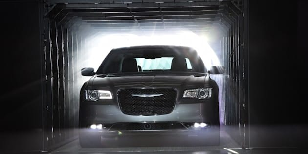 The 2015 Chrysler 300 C is unveiled at the Los Angeles Auto Show, November 19, 2014 in Los Angeles, California.      AFP PHOTO / ROBYN BECK        (Photo credit should read ROBYN BECK/AFP/Getty Images)