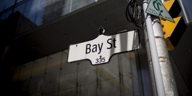 A 'Bay Street' sign hangs from a post in Toronto, Ontario, Canada, on Monday, June 17, 2013. The Canadian dollar declined for a third day versus its U.S. peer as the Federal Reserve starts a two-day meeting that may provide information about when the central bank will start to reduce bond purchases. Photographer: Brent Lewin/Bloomberg via Getty Images