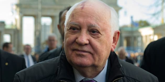 BERLIN, GERMANY - NOVEMBER 08:  Former soviet leader Mikhail Gorbatchev walks across the Pariser Platz near the Brandenburg Gate on the eve of the 25th  anniversary of the fall of the Berlin Wall on November 8, 2014 in Berlin, Germany. Gorbatchev's liberalization of the political climate within the Cold War-era eastern Bloc allowed for mass demonstrations and ultimately the overthrow of communist dictatorships across the region. Germany will celebrate  the 25th anniversary of the fall of the berlin wall on November 9 with a 15 km light installation that runs along the course of the former Berlin Wall that once divided Berlin into communist East and capitalist Wst.  (Photo by Target Presse Agentur Gmbh/Getty Images)
