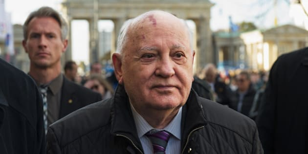 BERLIN, GERMANY - NOVEMBER 08:  Former soviet leader Mikhail Gorbatchev walks across the Pariser Platz near the Brandenburg Gate on the eve of the 25th anniversary of the fall of the Berlin Wall on November 8, 2014 in Berlin, Germany. Gorbatchev's liberalization of the political climate within the Cold War-era eastern Bloc allowed for mass demonstrations and ultimately the overthrow of communist dictatorships across the region. Germany will celebrate the 25th anniversary of the fall of the berlin wall on November 9 with a 15 km light installation that runs along the course of the former Berlin Wall that once divided Berlin into communist East and capitalist West.  (Photo by Target Presse Agentur Gmbh/Getty Images)