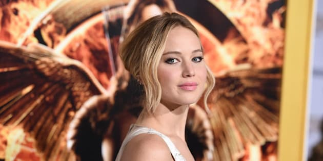"""Jennifer Lawrence arrives at the Los Angeles premiere of """"The Hunger Games: Mockingjay - Part 1"""" at the Nokia Theatre L.A. Live on Monday, Nov. 17, 2014 in Los Angeles. (Photo by Jordan Strauss/Invision/AP)"""