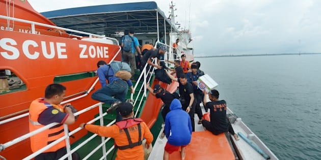 Members of an Indonesian search and rescue team prepare to set off to search at sea for missing AirAsia flight QZ8501 from Manggar in East Belitung on December 30, 2014. Dozens of planes and ships searching Indonesian waters for the missing AirAsia Airbus plane focused on a patch of oil for possible clues, as a senior official warned on December 29 the aircraft was likely at the bottom of the sea.     AFP PHOTO / ADEK BERRY        (Photo credit should read ADEK BERRY/AFP/Getty Images)