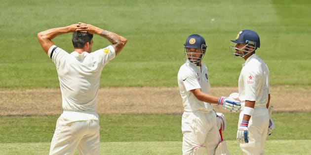 MELBOURNE, AUSTRALIA - DECEMBER 28:  Virat Kohli of India and bowler Mitchell Johnson of Australia exchange words at the end of an over after Kohli was struck by a throw at the stumps from Johnson as Ajinkya Rahane looks on during day three of the Third Test match between Australia and India at Melbourne Cricket Ground on December 28, 2014 in Melbourne, Australia.  (Photo by Scott Barbour/Getty Images)
