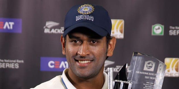 WELLINGTON, NEW ZEALAND - APRIL 07:  MS Dhoni of India holds the series trophy after day five of the Third Test match between New Zealand and India at the Basin Reserve on April 7, 2009 in Wellington, New Zealand.  (Photo by Marty Melville/Getty Images)