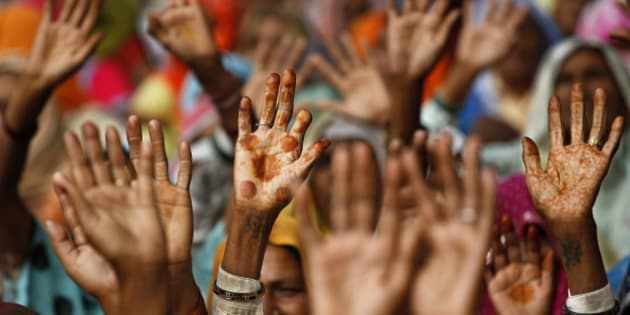 Women from rural northern India raise their hands during a protest in New Delhi, India, Thursday, Nov. 11, 2010.The protestors alleged the government was acquiring their fertile lands for different industrial projects including a nuclear plant at prices much lower than prevailing market rates. (AP Photo/Saurabh Das)