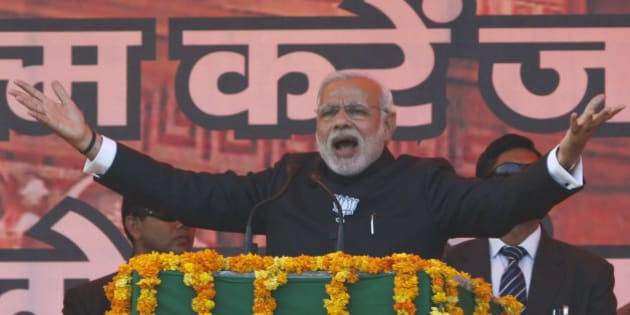 Indian Prime Minister Narendra Modi addresses an election campaign rally in Jammu, India, Tuesday, Dec. 16, 2014. The final phase of the five-phased state elections of Jammu and Kashmir will be held on Dec.  20. (AP Photo/Channi Anand)