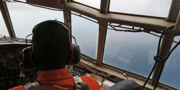 A crew of an Indonesian Air Force C-130 airplane of the 31st Air Squadron scans the horizon during a search operation for the missing AirAsia flight 8501 jetliner over the waters of Karimata Strait in Indonesia, Monday, Dec. 29, 2014. Search planes and ships from several countries on Monday were scouring Indonesian waters over which an AirAsia jet disappeared, more than a day into the region's latest aviation mystery. AirAsia Flight 8501 vanished Sunday in airspace thick with storm clouds on its way from Surabaya, Indonesia, to Singapore. (AP Photo/Dita Alangkara)