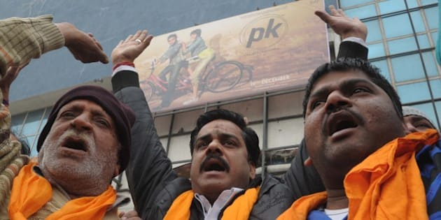 Activists from Shiv Sena, Sher-e-Punjab, shout slogans as they protest against the film 'PK' outside a cinema in Amritsar on December 23, 2014. The protest was held against the film for allegedly offending Shiv Sena religious sentiments. AFP PHOTO/ NARINDER NANU        (Photo credit should read NARINDER NANU/AFP/Getty Images)