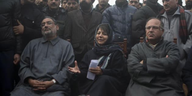 People's Democratic Party (PDP) leader Mehbooba Mufti, center, addresses the media at her residence in Srinagar, India, Tuesday, Dec. 23, 2014. The PDP won 28 seats and emerged as the single largest party in the recently concluded Jammu and Kashmir state elections. (AP Photo/Dar Yasin)