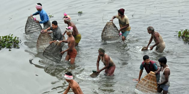 Tiwa tribe people participate in community fishing at the Jonbeel Mela on January 20, 2012. Hundreds of tribal communities like Tiwa, Karbi, Khasi, and Jaintia from nearby hills come in large numbers to take part in the festival exchange goods through barter rather than money. Community fishing is also held during this festival. The significant point of this festival is its theme of harmony and brotherhood amongst various tribes and communities. During the three day long Jonbeel festival these tribes and communities perform traditional dances and play music. AFP PHOTO/STR (Photo credit should read STRDEL/AFP/Getty Images)
