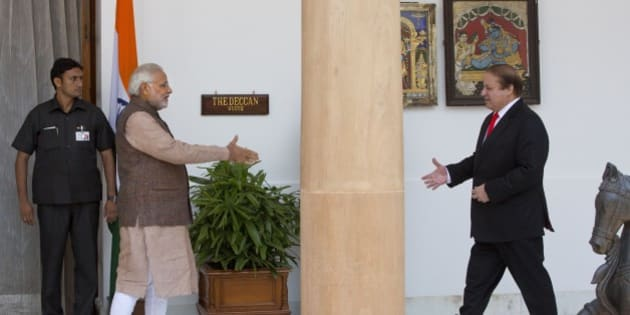 Indian Prime Minister Narendra Modi, left, walks to shake hand with his Pakistani counterpart Nawaz Sharif before the start of their meeting in New Delhi, India, Tuesday, May 27, 2014. Analysts say Sharif's visit could signal an easing of tensions between the often-hostile, nuclear-armed neighbors. No details were given about what the two men would discuss, but Modi is likely to ask Pakistan to hasten investigations into the Mumbai attack and put its perpetrators on trial. (AP Photo /Manish Swarup)