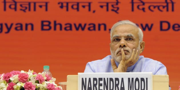 NEW DELHI, INDIA - AUGUST 28: Prime Minister Narendra Mod during the launch of Pradhan Mantri Jan Dhan Yojna at Vigyan Bhawan on August 28, 2014 in New Delhi, India.  Prime Minister Modi had announced the scheme to open bank accounts for all citizens of India in his maiden Independence Day address. Under Pradhan Mantri Jan Dhan Yojana every account holder gets a debit card with a Rs.1 lakh insurance cover. (Photo by Mohd Zakir/Hindustan Times via Getty Images)