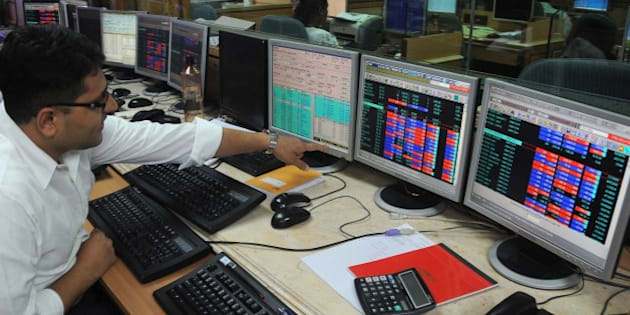 An Indian stock trader gestures on seeing the 30 share benchmark index SENSEX cross 24,000 points during intra-day trade at a brokerage house in Mumbai on May 13, 2014.  India's stock market surged for the third straight day to a record high May 13 as exit polls indicated that Hindu nationalist party leader Narendra Modi was on course to become the country's next prime minister.  AFP PHOTO/ INDRANIL MUKHERJEE        (Photo credit should read INDRANIL MUKHERJEE/AFP/Getty Images)
