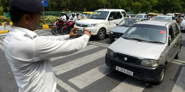 NEW DELHI, INDIA  JULY 15: Delhi Police official use digital camera to nab traffic violators in New Delhi. Traffic Police issued 70 still digital cameras to its zonal officers to nab stop-line violators.(Photo by Shekhar Yadav/India Today Group/Getty Images)