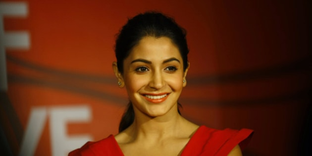 Bollywood actor Anushka Sharma smiles as she listens to a question from a journalist during a promotional event of a jewelry in Mumbai, India, Thursday, Jan. 24, 2013. (AP Photo/Rafiq Maqbool)