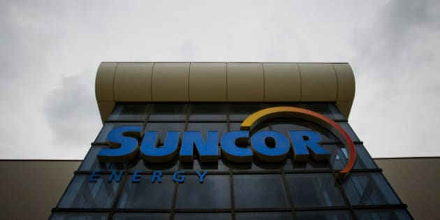 The Suncor Energy Inc. offices stand in Fort McMurray, Alberta, Canada, on Wednesday, June 19, 2014. Heavy crude from the oil sands has traded at an average of $18.70 per barrel below the U.S. benchmark over the last five years due to a transportation bottleneck in North America. The discount costs Canadas economy as much as C$50 million per day, according to the Canadian Chamber of Commerce. Photographer: Ben Nelms/Bloomberg via Getty Images