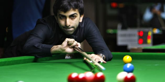 India's Pankaj Advani plays a shot during a round robin league match against Poland's Marcin Nitschke, unseen, at the International Billiards and Snooker Federation (IBSF) World Snooker Championship in Bangalore, India, Tuesday, Nov. 29, 2011. The six day event which started Monday have participants from 41 countries. (AP Photo/Aijaz Rahi)