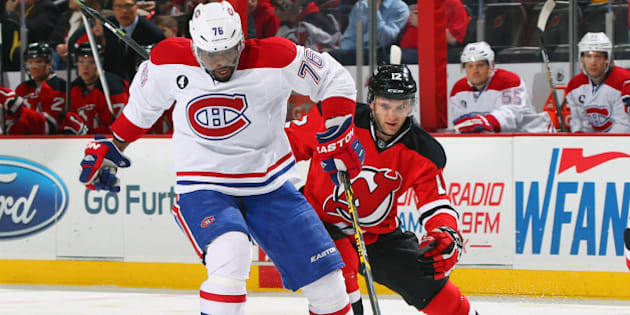 NEWARK, NJ - JANUARY 02: P.K. Subban #76 of the Montreal Canadiens controls the puck while being pursued by Tim Sestito #12 of the New Jersey Devils during the game at the Prudential Center on January 2, 2015 in Newark, New Jersey. (Photo by Andy Marlin/NHLI via Getty Images)