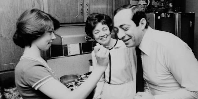 Mario Cuomo tastes cooking of daughter Margaret as Mrs. Cuomo looks on. (Photo By: Jim Garrett/NY Daily News via Getty Images)