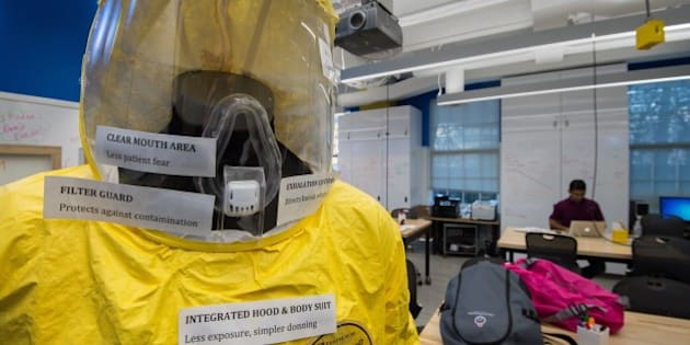 A new and improved prototype bio-hazard suit specifically targeted for viral outbreaks such as Ebola is seen at the Johns Hopkins Biomedical Engineering Laboratory for Innovation and Design on December 18, 2014. Made of Tyvek, the bright yellow outfit is easier than current Ebola protection suits to remove, lowering the risk of a health care worker contracting the deadly virus. It also features a ventilation system, making it possible to wear the suit for hours in West Africa's tropical heat without discomfort.    AFP PHOTO/PAUL J. RICHARDS        (Photo credit should read PAUL J. RICHARDS/AFP/Getty Images)