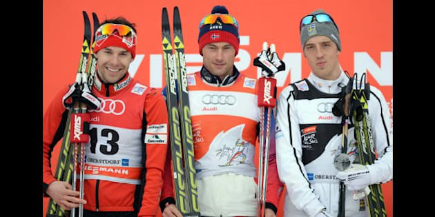 (L-R) Canadian Alex Harvey, Norwegian Petter Jr Northug and Swedish Calle Halfvarsson pose during the winner ceremony after the men's 15 kilometers pursuit classic style competition of the 'Tour de Ski' Cross Country World Cup on January 4, 2015 in Oberstdorf, southern Germany. Norway's Petter Jr Northug won the competition, Canadian Alex Harvey placed second and Swedish Calle Halfvarsson placed third.  AFP PHOTO / CHRISTOF STACHE        (Photo credit should read CHRISTOF STACHE/AFP/Getty Images)