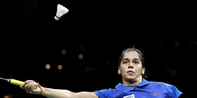 India's Saina Nehwal returns a shot to China's top seeded Li Xuerui, not seen, during their Quarter Final match at the World Badminton Championships at Ballerup Arena, Denmark, Friday, Aug. 29, 2014. (AP Photo/Jens Dresling, POLFOTO) DENMARK OUT
