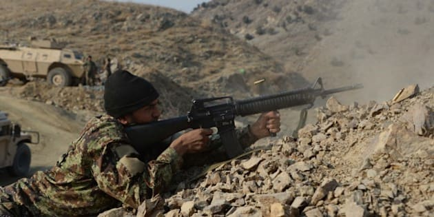 In this picture taken on January 3, 2015, an Afghan National Army (ANA) soldier fires during an ongoing anti-Taliban operation in Dangam district near the Pakistan-Afghanistan border in the eastern Kunar province. Afghan security forces have launched a joint anti-militant operations in several parts of Dangam district of Kunar province. So far in the operation, 157 armed insurgents have been killed and 112 others wounded, seven security personnel killed and six others were wounded in the past 25 days, police chief Abdul Habib SyedKhalil said. AFP PHOTO / Noorullah Shirzada        (Photo credit should read Noorullah Shirzada/AFP/Getty Images)