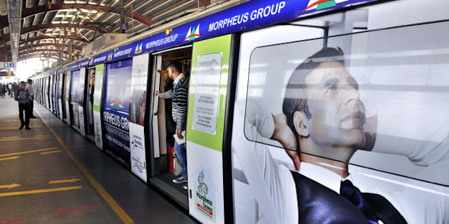 NEW DELHI, INDIA - NOVEMBER 22:  The first metro train with advertisement in its exterior part will be inducted into service on November 22, 2014 in New Delhi, India. This move is aimed at augmenting its non-operational revenues. The DMRC operates a fleet of over 200 trains at present with over 60 eight-coach trains and over 80 six-coach trains whose interiors have already been made available for the purpose of advertising. (Photo by Subrata Biswas/Hindustan Times via Getty Images)