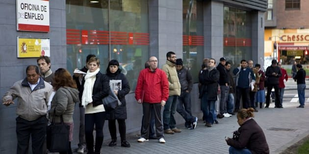 People wait in line at a government employment office on Paseo de las Acacias in Madrid on December 2, 2014. Spain's jobless queue shrank in November, ending three months of increases, as the economy slowly recovered after emerging in mid-2013 from a two year recession, the government said. The number of people in Spain registered as unemployed fell by 14,688 in November from the previous month to hit 4,512,116. AFP PHOTO/ SEBASTIEN BERDA        (Photo credit should read SEBASTIEN BERDA/AFP/Getty Images)