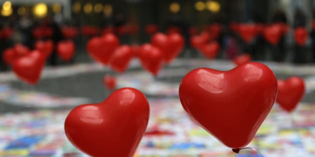Heart-shaped balloons float as part of an exhibition for children suffering heart diseases in Milan, Italy, Saturday, Dec. 13, 2014. (AP Photo/Antonio Calanni)